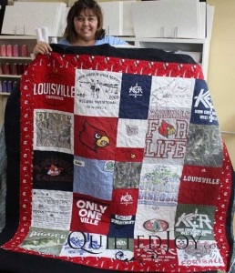 T-shirt quilt with lots of University of Louisville shirts. Renee used an APQS longarm machine to quilt this.