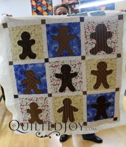 Gingerbread Men Christmas wall hanging. Free motion quilting on APQS longarm machine at Quilted Joy