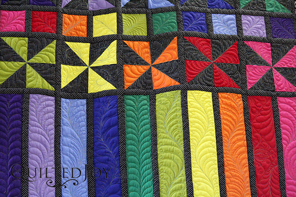 Feathers in a pinwheel quilt block
