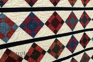Nelda's nine patch variation with flying geese border - QuiltedJoy.com