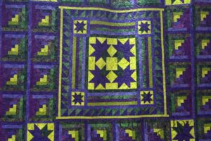 A Starry Log Cabin Quilt. Machine quilting by Angela Huffman with the Cascade pantograph