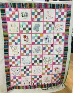 Pat's embroidered animals baby quilt. Quilted at QuiltedJoy.com