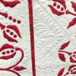Red December by Gail H. Smith and Angela McCorkle at AQS Quilt Week Paducah 2016