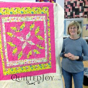 Susan's Carpenter's Saw block quilt. Quilted at QuiltedJoy.com