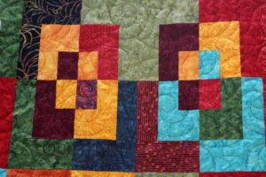 Once Around the Block quilt, quilted by Angela Huffman using the Pipeline Pantograph