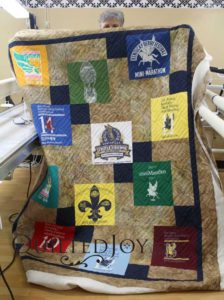 Colleen's T-shirt quilt for a mini marathon runner. Quilted with Square Spiral pantograph at Quilted Joy