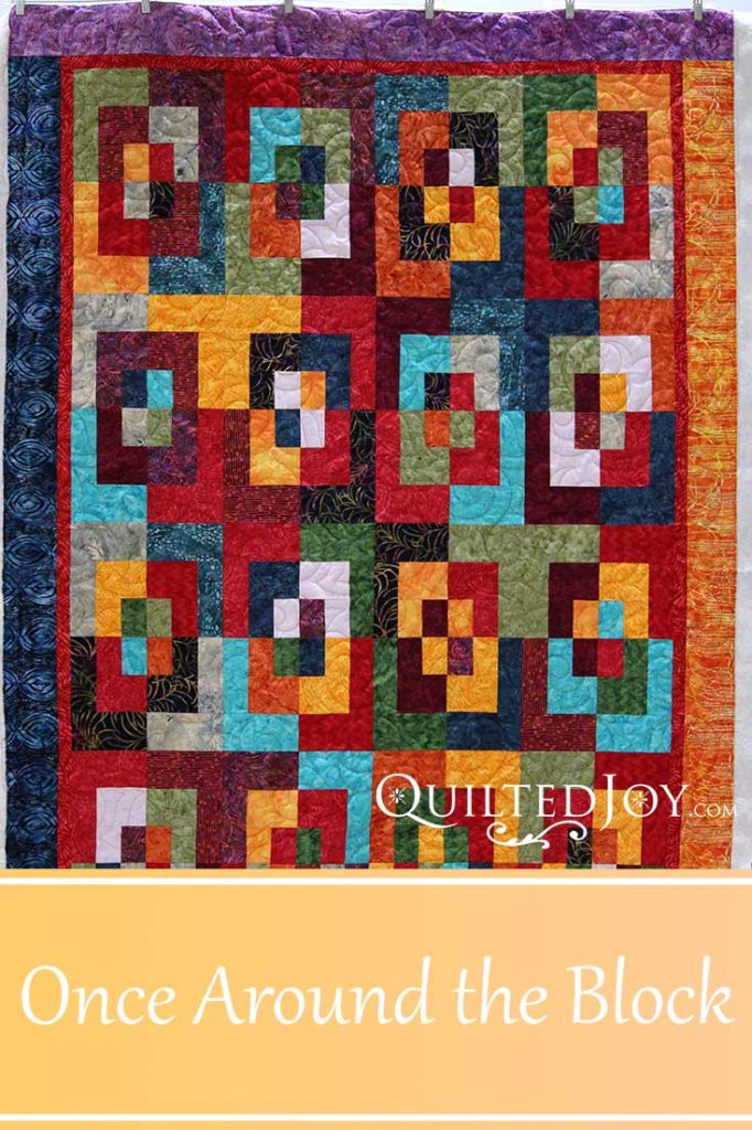 Paula's quilt Once Around the Block, quilted by Angela Huffman