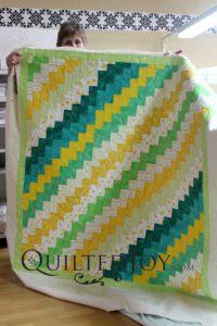 Jean's Stair Step Quilt, quilted with a feathers design board at Quilted Joy