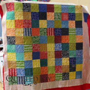 Sarah's layer cake for her rental certification class. Can you find all her quilting doodles?