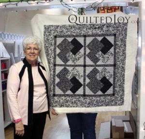 Suzy's card trick quilt after using the longarm machine for the first time.
