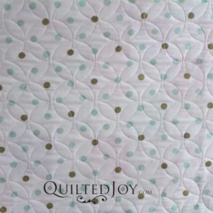 Donna's Pinwheels baby quilt. Quilted with an Orange Peel design board at Quilted Joy