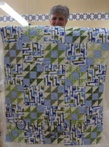 Colleen's baby quilt for her grandson. She added a simple free motion meander with our APQS longarm machines