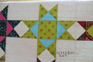 Close up of Erin's super-sized Ohio Star quilt, quilted at Quilted Joy on APQS longarm machines