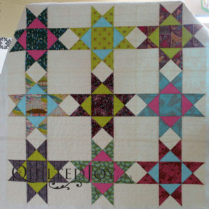Erin's super-sized Ohio Star quilt. Quilted at Quilted Joy.
