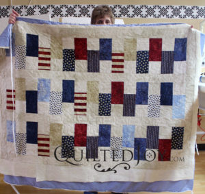 A prayer quilt. Jean quilted a meandering design using Quilted Joy's design boards and APQS longarm quilting machines