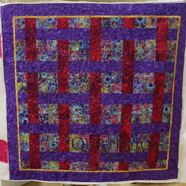 Angela Huffman at Quilted Joy helped renter LuAnn with this lattice flower garden quilt.