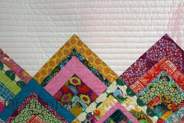 Angela Huffman, Quilted Joy, helps Erin quilt a modern log cabin. It's from Erin's new pattern Rinse and Repeat.