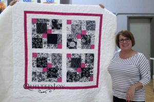 Debi quilted this using an APQS longarm machine for the first time!