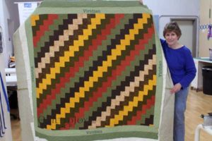 Jean quilted her quilt with an APQS longarm quilting machine at Quilted Joy