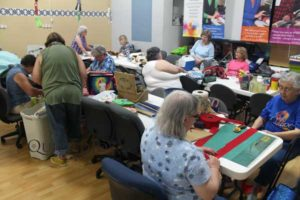 Louisville Nimble Thimbles invaded the Quilted Joy classroom during their Cuddle Care quilt-a-thon