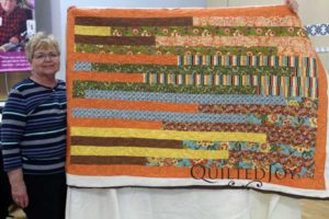 Helen's jelly roll race quilt after her APQS longarm rental certification class at Quilted Joy
