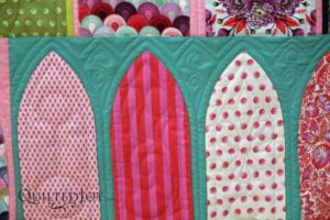 Longarm Quilter Angela Huffman always kept the density of the design in mind while quilting each arch