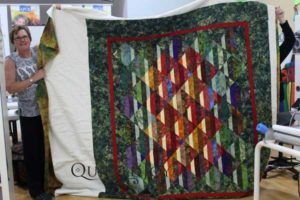 Kim's Strip Club quilt, quilted at Quilted Joy