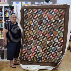 Nancy's Signature Block quilt, quilted at Quilted Joy
