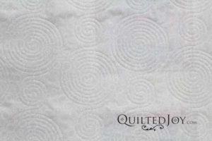 "Tone on Tone Dotted Circles 108"" width cotton fabric, quilted."
