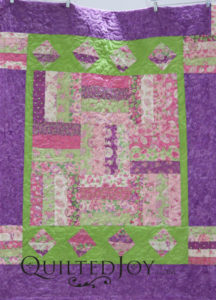 This flowery quilt pieced by Karee demonstrates what to do both to use up your stash and to make your quilt reversible.