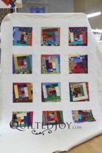 Tammie's Wonky Log Cabin quilt, quilted at Quilted Joy