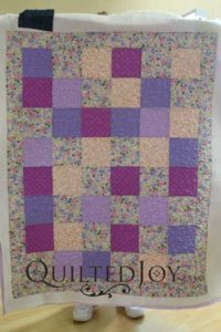 Vivian's floral Layer Cake quilt, quilted at Quilted Joy
