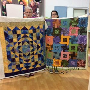 Dianna is taking advantage of Quilted Joy's longarm quilting machine rental program to knock out lots of unfinished quilts!