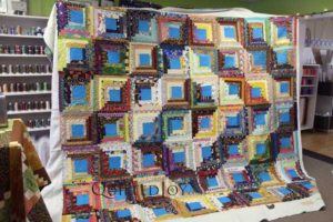This scrappy log cabin quilt is a wedding gift for Pat's nephew