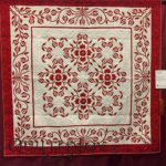 """Red December"" pieced by Gail H. Smith and quilted by Angela McCorkle at MQX Midwest 2016"
