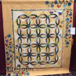 """Wedding Rings and Flowers"" pieced by Carolyn Stine and quilted by Maureen Mueller at MQX Midwest 2016"