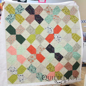 Erin's XOXO Charity quilt with a free hand orange peel design