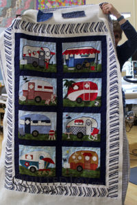 Jean's adorable camper quilt with free motion quilting at Quilted Joy