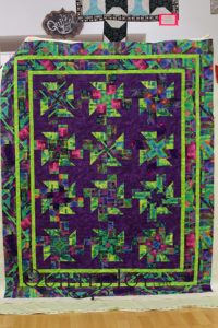 Dianna's colorful and energetic quilt. Quilted at Quilted Joy