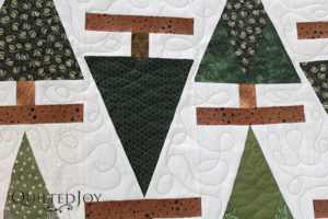 Dianna custom quilted this tree quilt on an APQS longarm machine at Quilted Joy
