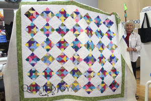 Donna's strip sets quilt was quilted on a longarm machine at Quilted Joy