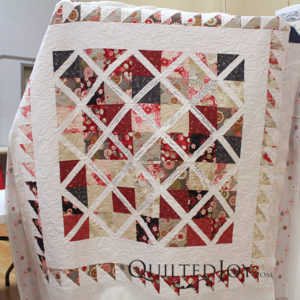 Pam's wedding gift for a coworker, quilted on an APQS longarm machine at Quilted Joy