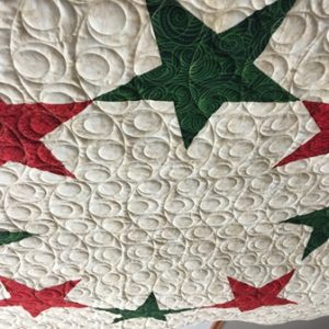 Christmas Tree Skirt, pattern by Dawn Cavanaugh and quilted by Susan Rubino and Chris Wenz