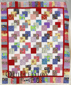 Virginia's scrappy charm quilt, quilted by Angela Huffman at Quilted Joy
