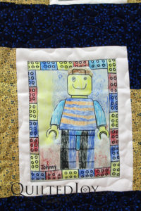 "This work of art is made up of artwork printed on fabric ""blocks"" which were made into a top. See how Angela quilted it to bring out the art!"