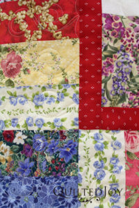 Virginia's Scrappy Charm Quilt with Just Leaves Pantograph, quilted by Angela Huffman at Quilted Joy