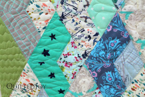 """Close up of Anna's modern quilt with free motion """"doodle"""" quilting"""