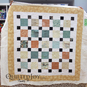 Anna's contemporary quilt, quilted with the Honey Drops pantograph