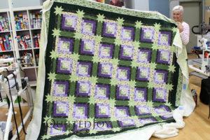 Bertie's log cabin quilt with hidden stars