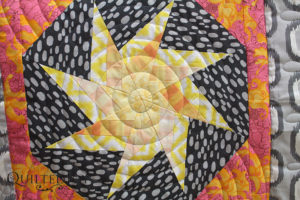 Close up of star on Charlotte's modern quilt
